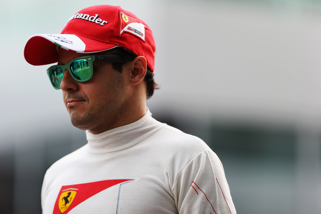 Hi-res-185914006-felipe-massa-of-brazil-and-ferrari-walks-in-the-paddock_crop_650
