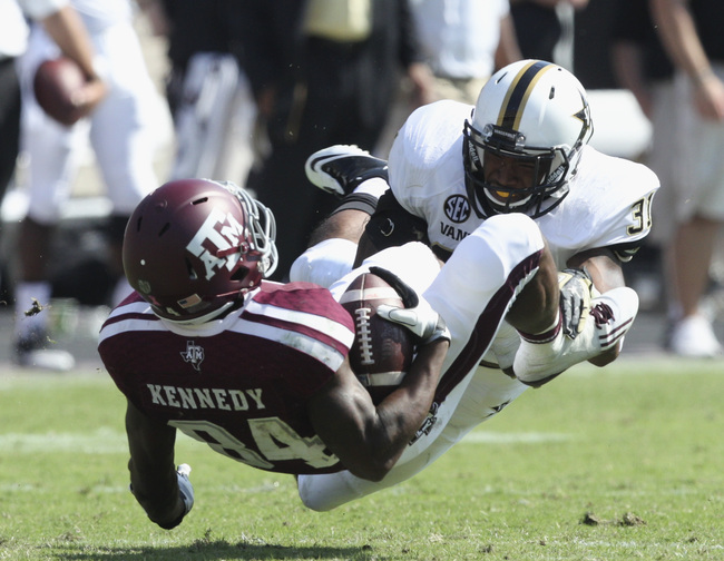Hi-res-185942970-javon-marshall-of-the-vanderbilt-commodoresn-tackles_crop_650