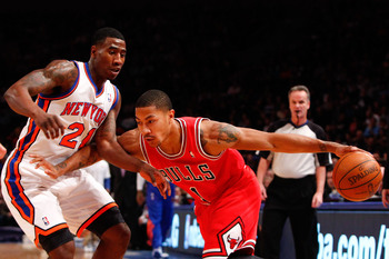 Iman Shumpert covering Derrick Rose driving to the hoop