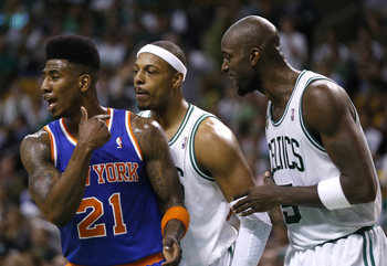 Iman Shumpert with Paul Pierce and Kevin Garnett in his ear