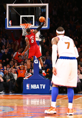 LeBron James with a huge dunk to seal the Heat victory as Carmelo Anthony watches