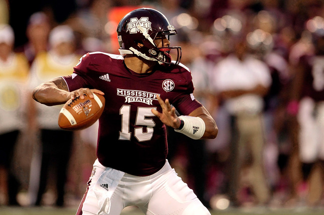 STARKVILLE, MS - OCTOBER 05:  Dak Prescott #15 of the Mississippi State Bulldogs drops back to pass against the LSU Tigers during a game at Davis Wade Stadium on October 5, 2013 in Starkville, Mississippi.  (Photo by Stacy Revere/Getty Images)