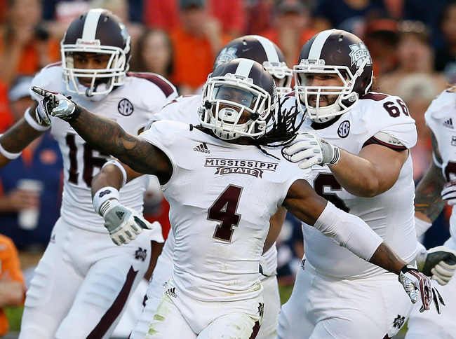 AUBURN, AL - SEPTEMBER 14:  Jameon Lewis #4 of the Mississippi State Bulldogs celebrates scoring a touchdown against the Auburn Tigers at Jordan-Hare Stadium on September 14, 2013 in Auburn, Alabama.  (Photo by Kevin C. Cox/Getty Images)