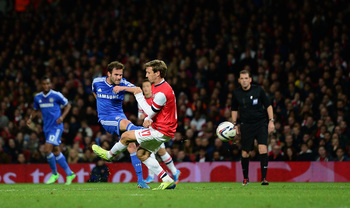 Hi-res-186224655-juan-mata-of-chelsea-shoots-to-score-his-sides-second_display_image