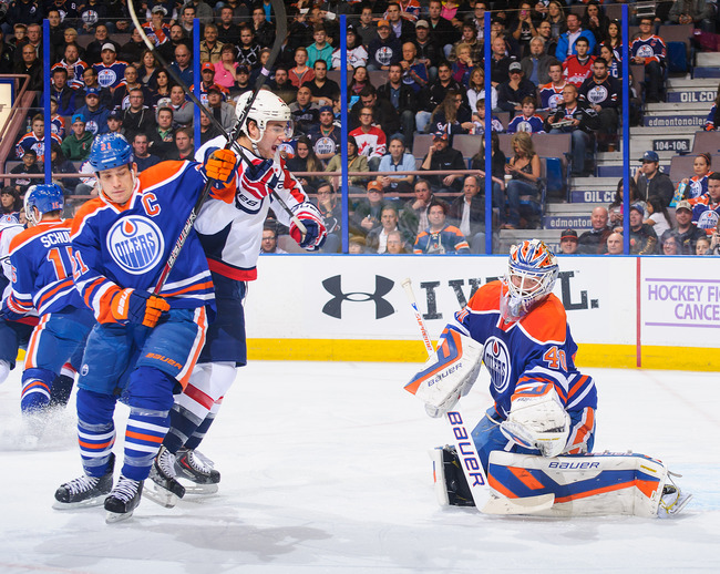 Hi-res-185770133-devan-dubnyk-of-the-edmonton-oilers-watches-the-shot-of_crop_650