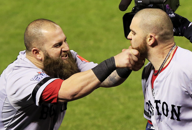 Hi-res-186064334-mike-napoli-of-the-boston-red-sox-pulls-teammate-jonny_crop_650x440