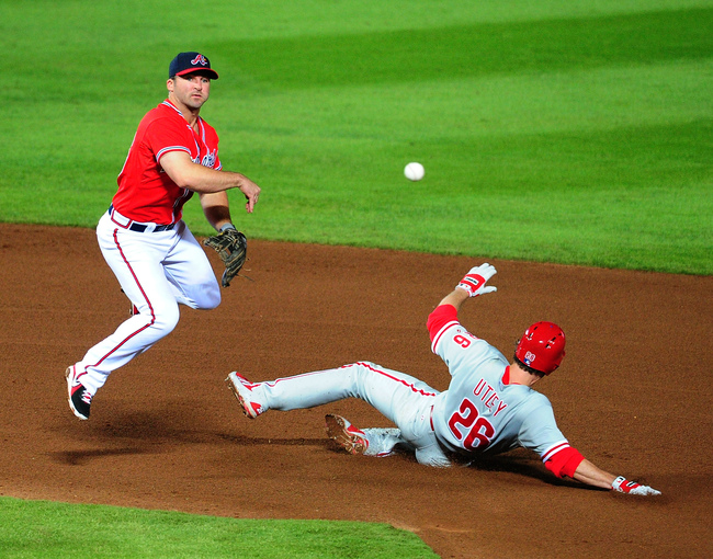 Hi-res-182057211-dan-uggla-of-the-atlanta-braves-turns-a-double-play_crop_650