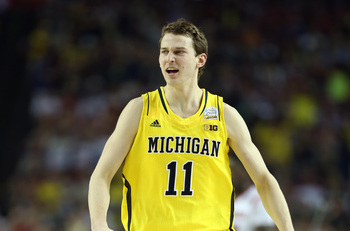 Hi-res-166733700-nik-stauskas-of-the-michigan-wolverines-reacts-against_display_image