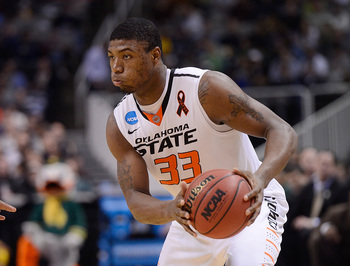 Hi-res-164287089-marcus-smart-of-the-oklahoma-state-cowboys-looks-to_display_image