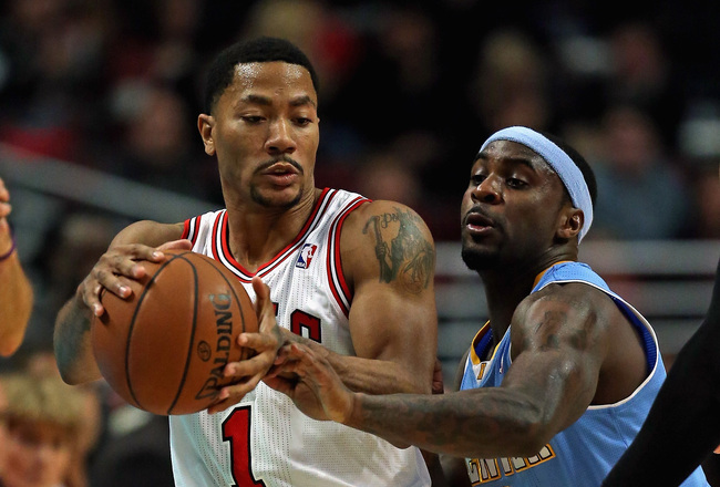 Hi-res-186107423-derrick-rose-of-the-chicago-bulls-controls-the-ball_crop_650x440