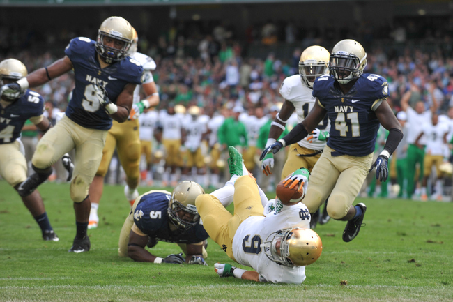 Hi-res-151111218-robby-toma-of-notre-dame-dives-for-a-touchdown-during_crop_650