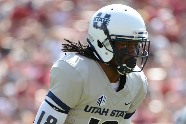 Hi-res-182591429-ronald-butler-of-the-utah-state-aggies-runs-against-the_crop_650