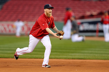 Hi-res-185592654-mike-carp-of-the-boston-red-sox-warms-up-during-team_display_image