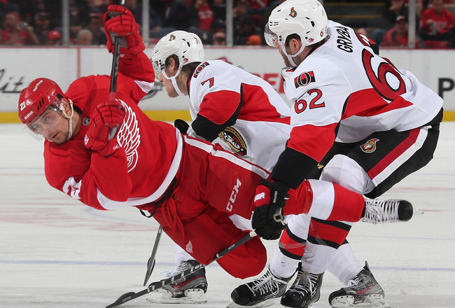 Hi-res-185678329-tomas-tatar-of-the-detroit-red-wings-is-tripped-up-by_crop_650x440