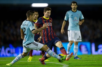 Hi-res-186237295-lionel-messi-of-fc-barcelona-competes-for-the-ball-with_display_image