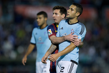 Hi-res-186237878-lionel-messi-of-fc-barcelona-embraces-hugo-mallo-of-rc_display_image