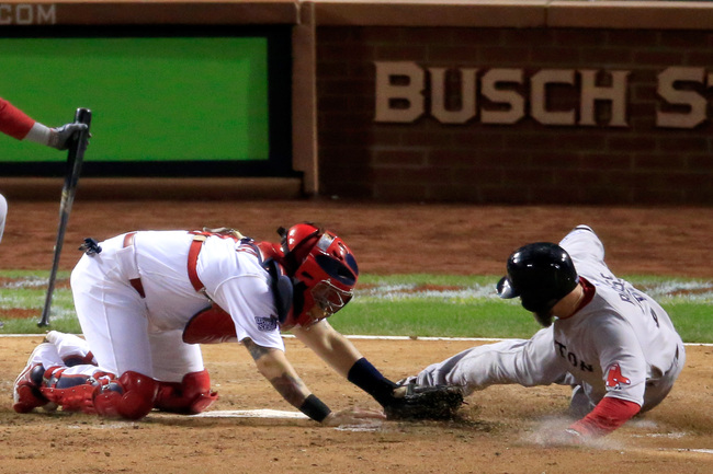 Hi-res-186154990-yadier-molina-of-the-st-louis-cardinals-gets-the-out-on_crop_650