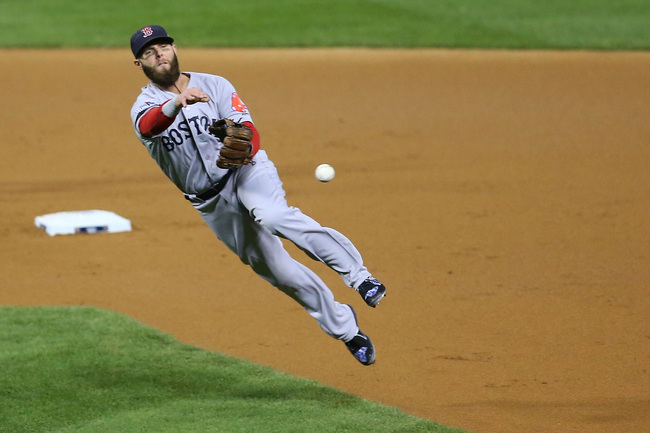 Hi-res-186141510-dustin-pedroia-of-the-boston-red-sox-fields-a-ball-hit_crop_650