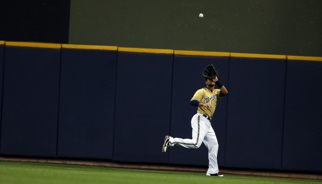Hi-res-180645292-carlos-gomez-the-milwaukee-brewers-makes-a-catch-in-the_crop_650