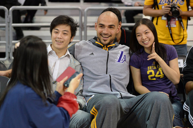 Hi-res-185037122-robert-sacre-of-the-los-angeles-lakers-takes-photos_crop_650