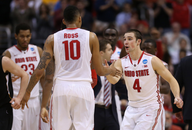 Hi-res-165113484-aaron-craft-of-the-ohio-state-buckeyes-gives-teammate_crop_650x440