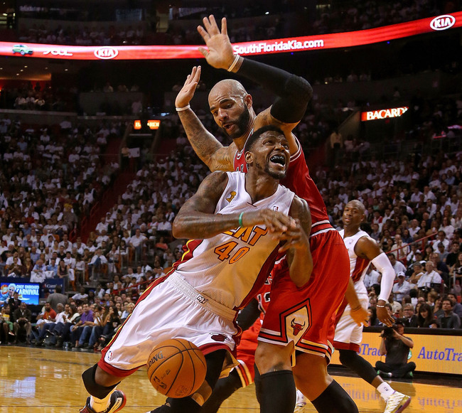 Hi-res-186259361-udonis-haslem-of-the-miami-heat-drives-against-carlos_crop_650
