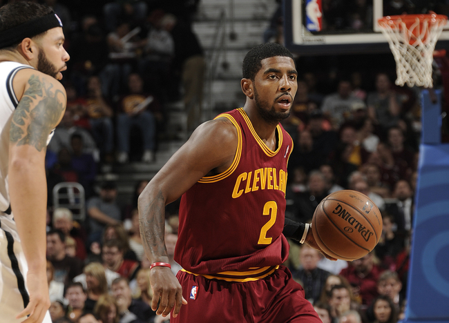 Hi-res-186370327-kyrie-irving-of-the-cleveland-cavaliers-looks-to-pass_crop_650