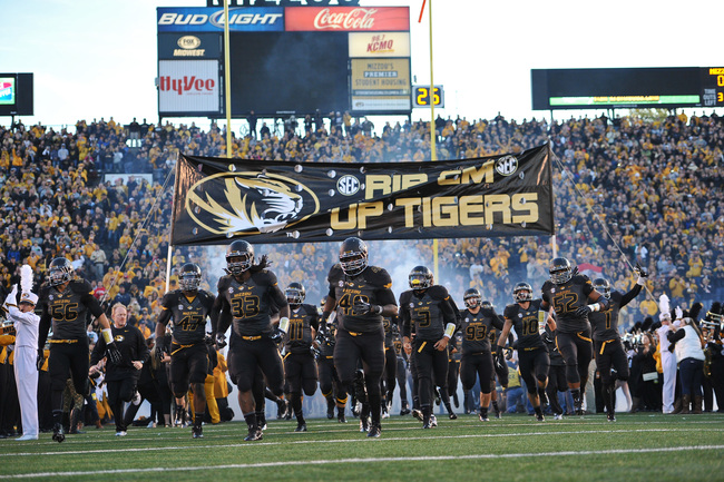Hi-res-185975417-the-missouri-tigers-run-onto-the-field-before-a-game_crop_650