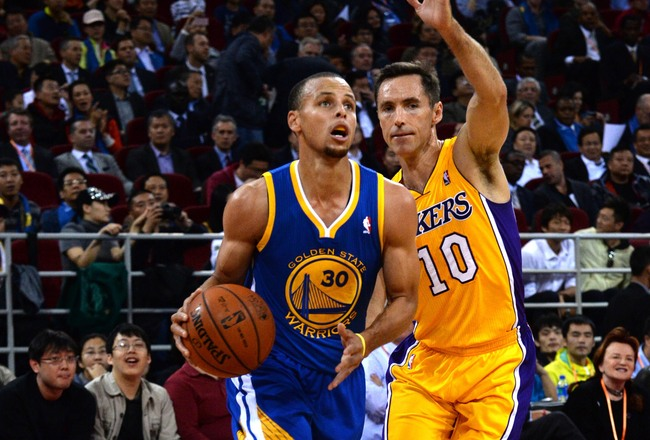 Hi-res-184675693-stephen-curry-of-the-golden-state-warriors-drives_crop_650x440