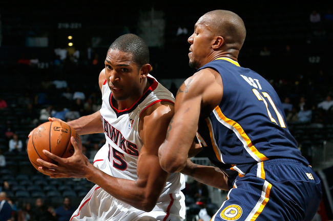Hi-res-185596646-al-horford-of-the-atlanta-hawks-drives-against-david_crop_650