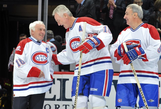 Hi-res-94175847-henri-richard-chats-with-larry-robinson-before-the-nhl_crop_650x440