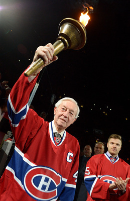 Jean Beliveau carries the torch.