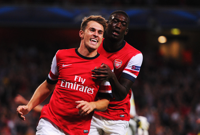 Hi-res-178222617-aaron-ramsey-of-arsenal-celebrates-with-team-mate-yaya_crop_650