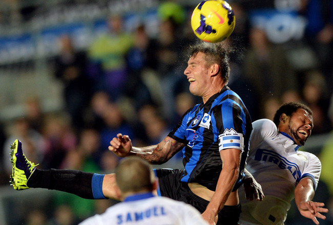 Hi-res-186238031-gustavo-german-denis-of-atalanta-bc-and-rolando-of-fc_crop_650x440