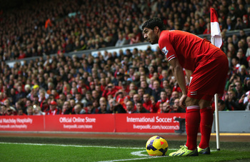 Hi-res-185933195-luis-suarez-of-liverpool-prepares-to-take-a-corner_display_image