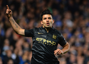 Hi-res-186027693-sergio-aguero-of-manchester-city-celebrates-scoring_display_image
