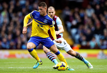 Hi-res-185918091-ross-barkley-of-everton-holds-off-pressure-from-ron_display_image