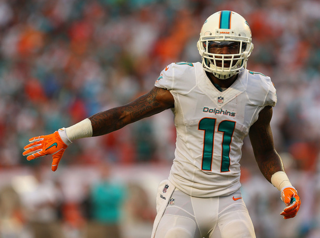 Hi-res-181594341-mike-wallace-of-the-miami-dolphins-looks-on-during-a_crop_650