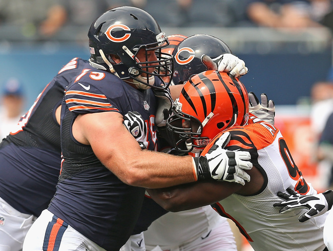 Hi-res-180222582-kyle-long-of-the-chicago-bears-blocks-geno-atkins-of_crop_650