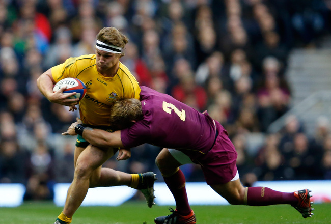 Hi-res-156582712-michael-hooper-of-australia-is-tackled-by-tom-youngs-of_crop_650x440