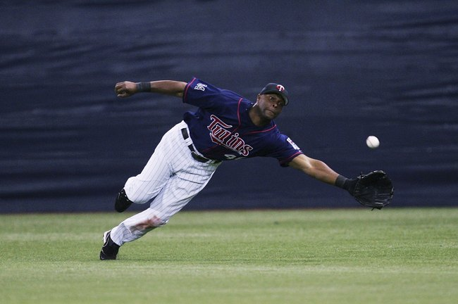 Hi-res-72086938-torii-hunter-of-the-minnesota-twins-tries-to-reach-a_crop_650