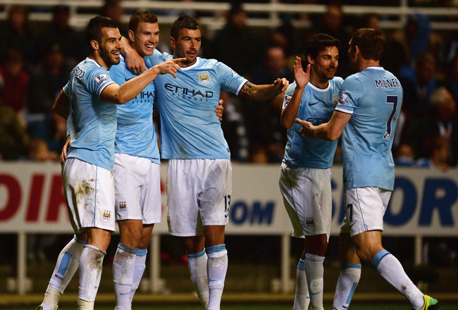 Hi-res-186357606-edin-dzeko-of-manchester-city-celebrates-scoring-their_crop_650x440