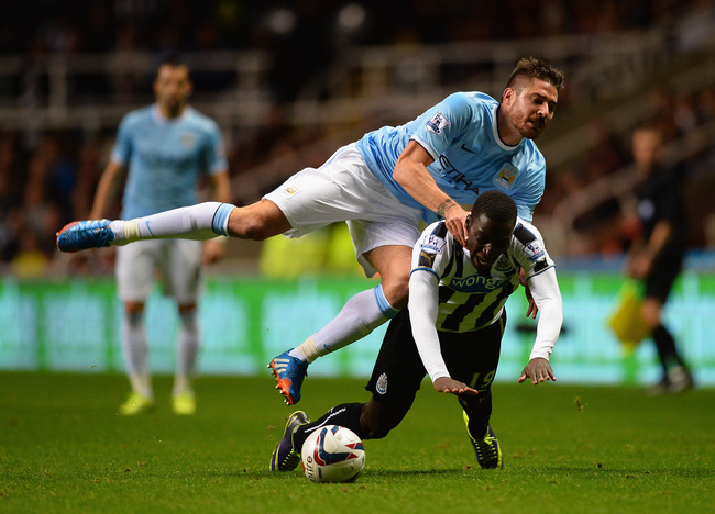 Hi-res-186345096-javi-garcia-of-manchester-city-clashes-with-massadio_crop_650