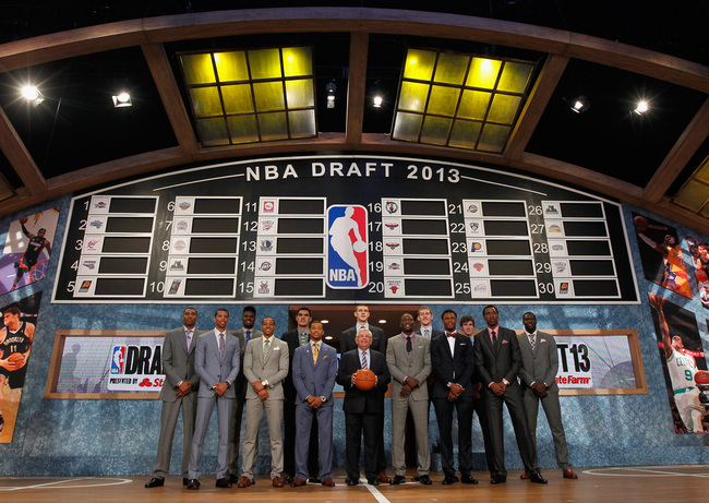 Hi-res-171668555-commissioner-david-stern-poses-with-the-2013-nba-draft_crop_650