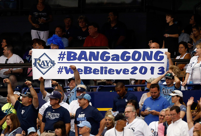 Hi-res-165287301-fans-of-the-tampa-bay-rays-hold-up-a-sign-during-the_crop_650x440