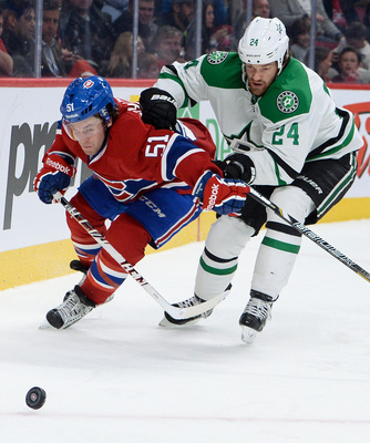 Montreal Canadiens forward David Desharnais and Dallas Stars defenseman Jordie Benn.