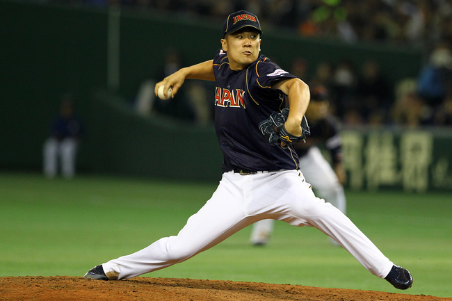 Hi-res-163368085-pitcher-masahiro-tanaka-of-japan-pitches-during-the_crop_650