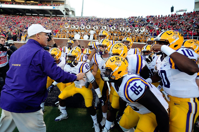 Hi-res-185369451-les-miles-head-coach-of-the-lsu-tigers-leads-his-team_crop_650