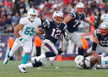 Hi-res-186043344-tom-brady-of-the-new-england-patriots-runs-the-ball_display_image