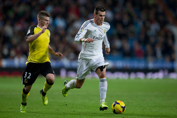 Hi-res-186369617-gareth-bale-of-real-madrid-cf-competes-for-the-ball_display_image